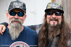 Custom bike builder Pat Patterson (R) with his brother Jeff Ford at the Flying Piston Builder Breakfast at the Buffalo Chip during the 78th annual Sturgis Motorcycle Rally. Sturgis, SD. USA. Sunday August 5, 2018. Photography ©2018 Michael Lichter.