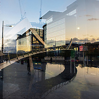Double exposure image of the Squiggly Bridge and the Glasgow's financial district on the Broomielaw