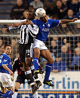 Photo. Matthew Lewis.<br />Leicester City v Newcastle United. FA Barclaycard Premiership. 26/12/2003.<br /><br />Newcastle's Titus Bramble and Leicester's Les Ferdinand challenge for the ball.