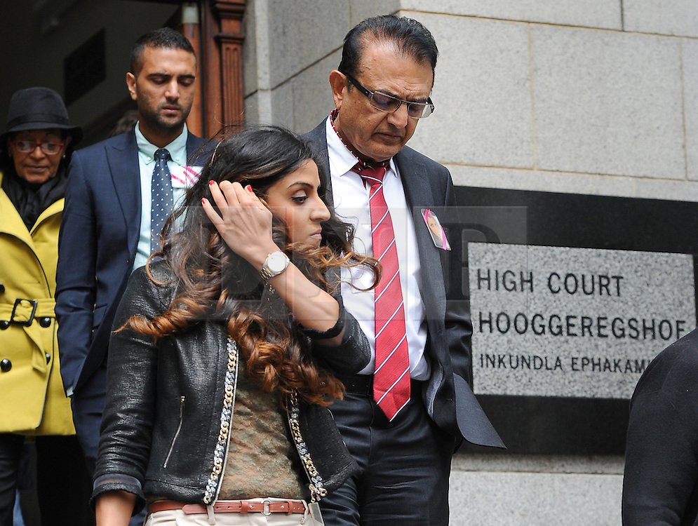 © Licensed to London News Pictures. 08/10/14. CAPE TOWN, SOUTH AFRICA -    Vinod Hindocha, father of Anni Dewani, leaves court with his niece Nishma Hindocha during Day 3 of the Shrien Dewani trial at the Cape High Court before Judge Jeanette Traverso. Dewani is caused of hiring hit men to murder his wife, Anni. Anni Ninna Dewani (née Hindocha; 12 March 1982 – 13 November 2010) was a Swedish woman who, while on her honeymoon in South Africa, was kidnapped and then murdered in Gugulethu township near Cape Town on 13 November 2010 . Photo credit : Roger Sedres/LNP