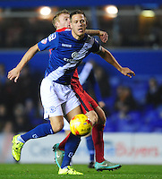 Blackburn Rovers' Chris Taylor vies for possession with Birmingham City's Michael Morrison<br /> <br /> Photographer Chris Vaughan/CameraSport<br /> <br /> Football - The Football League Sky Bet Championship - Birmingham City v Blackburn Rovers - Tuesday 3rd November 2015 - St Andrews - Birmingham<br /> <br /> © CameraSport - 43 Linden Ave. Countesthorpe. Leicester. England. LE8 5PG - Tel: +44 (0) 116 277 4147 - admin@camerasport.com - www.camerasport.com