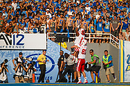 Ameer Abdullah #8 scores in his first career start, in place of an injured Rex Burkhead, in a 36-30 loss at UCLA's Rose Bowl on Sept. 8, 2012.
