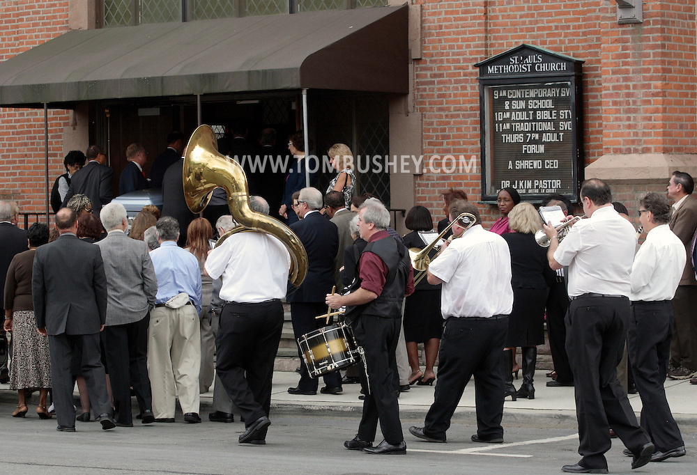 Middletown, New York - Mourners enter the St. Paul's Methodist Church for the funeral of Willie Carter as a Dixieland band plays on West Main Street on Sept. 19, 2010.