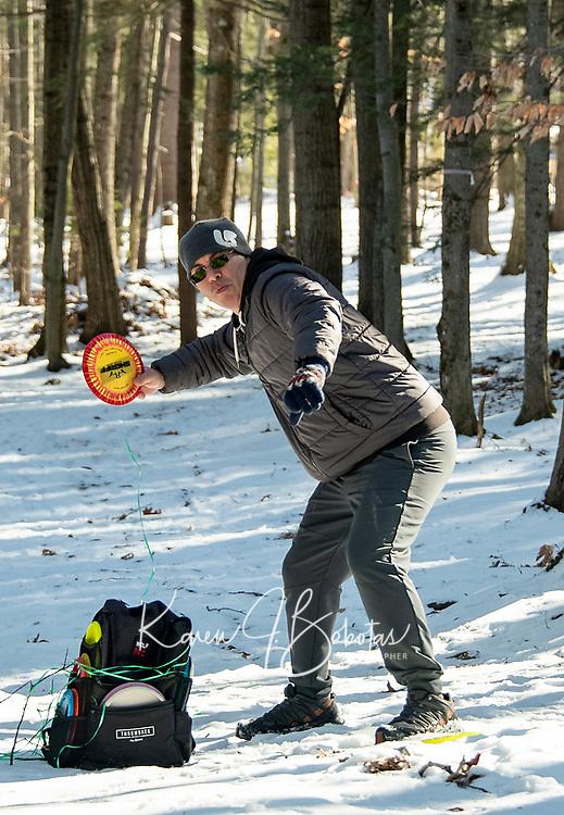 Eric Benevides takes a shot at the Chris Daigle Memorial Disc Golf Course in Bolduc Park Friday afternoon.  (Karen Bobotas Photo/for The Laconia Daily Sun)