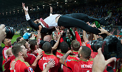 ZENICA, BOSNIA & HERZEGOVINA - Saturday, October 10, 2015:  Wales manager Chris Coleman is thrown into the air by his players after securing a place at next years Euro Championships after the Bosnia & Herzegovina vs Wales match at the Stadion Bilino Polje during the UEFA Euro 2016 qualifying Group B match. (Pic by Peter Powell/Propaganda)