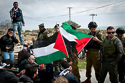 © London News Pictures. 14/03/2011. Villagers demonstrate against the continued building of Israeli settlements on Palestinian land in Al ma' sara just outside Bethlehem in the occupied West Bank. Palestinians have lost large amounts of fertile farm land to the security barrier and Israeli settlements. 13/03/11