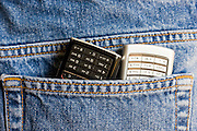 Two mobile phones in jeans pocket