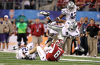 Kansas Sate Arthur Brown (4) and Meshak Williams (42) take down Arkansas quarterback Tyler Wilson (8) during the 2012 AT&T Cotton Bowl game between Arkansas and Kansas State at Cowboy Stadium in Arlington, Tx. on Jan 6th, 2012.
