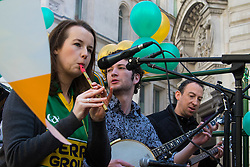 London, March 13th 2016. The annual St Patrick's Day Parade takes place in the Capital with various groups from the Irish community as well as contingents from other ethnicities taking part in a procession from Green Park to Trafalgar Square.  PICTURED: An Irish folk band play on the back of one of the floats. ©Paul Davey<br /> FOR LICENCING CONTACT: Paul Davey +44 (0) 7966 016 296 paul@pauldaveycreative.co.uk