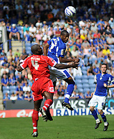 Photo: Tony Oudot/Richard Lane Photography. Leicester City v Barnsley. Coca Cola Championship. 22/08/2009. <br /> Danny N'Guessan of Leicester heads past Darren Moore of Barnsley