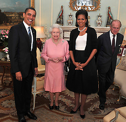01/04/2009. US President Barack Obama and Michelle Obama, talk with Queen Elizabeth II and the Duke of Edinburgh during an audience at Buckingham Palace in London. The Royal couple will celebrate their platinum wedding anniversary on November 20.