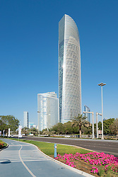 Modern office towers (Landmark Tower on the right) and cycle track  along Corniche in Abu Dhabi United Arab Emirates