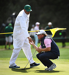 April 6, 2017 - Augusta, GA, USA - Caddie Brandon Antus returns William McGirt's golf ball to him prior to McGirt putting on the 17th green during first round action of the 2017 Masters Tournament at Augusta National Golf Club on Thursday, April 6, 2017 in Augusta, Ga. McGirt finished the round at -3. (Credit Image: © Jeff Siner/TNS via ZUMA Wire)
