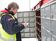 Photo Randy Vanderveen<br /> Grande Prairie, Alberta, Canada<br /> 2017-01-05<br /> Rob Carbrey  sorts mail into a community mailbox in Royal Oaks. New neighbourhoods have community mailboxes while older neighbourhoods are still provided with door to door service.