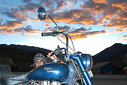 India, Serchu night camp, between Manali and Leh, Kullu District, Himachal Pradesh, Northern India European tourist caring for his motorbike
