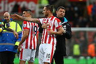 an angry Marko Arnautovic of Stoke City is pulled away after the final whistle. Barclays Premier league match, Stoke city v Manchester city at the Britannia Stadium in Stoke on Trent, Staffs on Saturday 5th December 2015.<br /> pic by Chris Stading, Andrew Orchard sports photography.