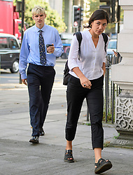 © London News Pictures. 14/09/2016. London, UK. BEN TIPPET (left) and NATALIE FIENNES, cousin of actors Ralph Fiennes arrive at Westminster Magistrates Court in London where they are two of nine Black Lives Matter campaigners who face charges relating to a protest at London City Airport on September 6, in which the protest group locked themselves together on the airport's runway.  Photo credit: Ben Cawthra/LNP