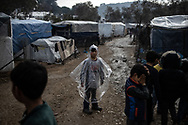 A child coverd with some plastic during a rainy day in the makeshift camp. About 20000 are living in a makeshift camp nearby the city of Moria on the island of Lesbos in miserable conditions, most of the without water, electricity nor sanitary facilities.  Federico Scoppa