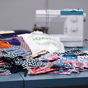 Face masks that were created with donated materials from Jo-Ann fabric stores lay on a table at a Jo-Ann Fabrics store on Friday, March 27, 2020 in Orlando, Florida. Jo-Ann is providing free materials, sewing machines, workspace and guidance in their stores so that individuals can safely make gowns and masks for immediate donation to local hospitals. (Alex Menendez via AP)