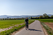 A man cycling alone in the fields of Oberursel in times of social distancing because of the corona virus.