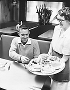 "Ackroyd 06354-13""The 'choose your own' tray has perked pie sales to over 1000 a month. Owner Daggatt (left) tries one."" (similar image caption published in Restaurant Management magazine, January 1956, pg. 69) Photo taken September 21, 1955"" (4x5"")"