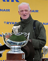 National Hunt Horse Racing - 2019 Cheltenham Festival - Thursday, Day Three (St Patrick's Day)<br /> <br /> Trainer, Willie Mullins trainer of Min with the trophy in the 14.50 Ryan Air Steeple Chase (Grade 1, Class 1), at Cheltenham Racecourse.<br /> <br /> COLORSPORT/ANDREW COWIE
