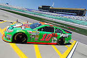 Danica Patrick heads back to the garage area after a practice run for a NASCAR Sprint Cup series auto race, Friday, May 9, 2014, at Kansas Speedway in Kansas City, Kan. (AP Photo/Colin E. Braley)