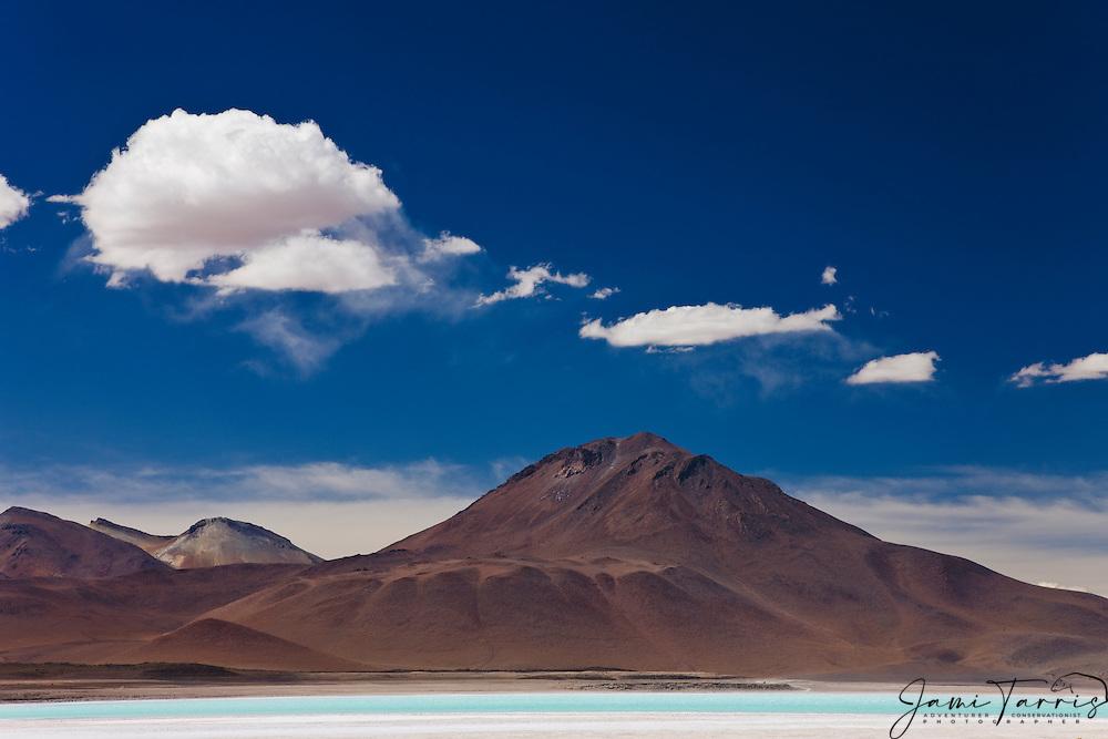 Clouds drifting above laguna Verde at the foot of volcano Licancabur, southwestern Altiplano, Bolivia,South America