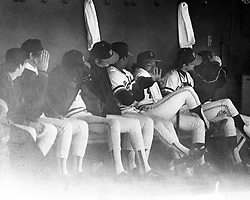 San Francisco Giants bench trys to shield from a gust of wind & dust at Candlestick Park 1979. (photo by Ron Riesterer)