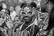 Masked girl at  the Endymion Parade during the 2019 Mardis Gras season in New Orleans.