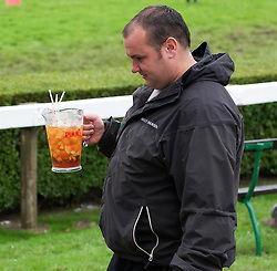 © Licensed to London News Pictures. 10/07/2012..Harrogate, England...A jug of Pimms made things easier as heavy rain and mud made for an interesting start to England's premier agricultural show which opened it's gates today for the start of three days of showcasing the best in British farming and the countryside. ..The event, which attracts over 130,000 visitors each year is the 154th show and displays the cream of the country's livestock and offers numerous displays and events and gives the chance to see many different countryside activities...Photo credit : Ian Forsyth/LNP