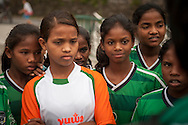 Yuwa team players listen to coach's explanation, before the match against Añorga team, Donostia-San Sebastian (Basque Country)  02 July 2013. Yuwa Jharkhand is a program for girls aged 5-17 to promote health, education and improved livelihoods through football. Yuwa team was in Donostia playing Donosti Cup international football tournament (Gari Garaialde/Bostok Photo)