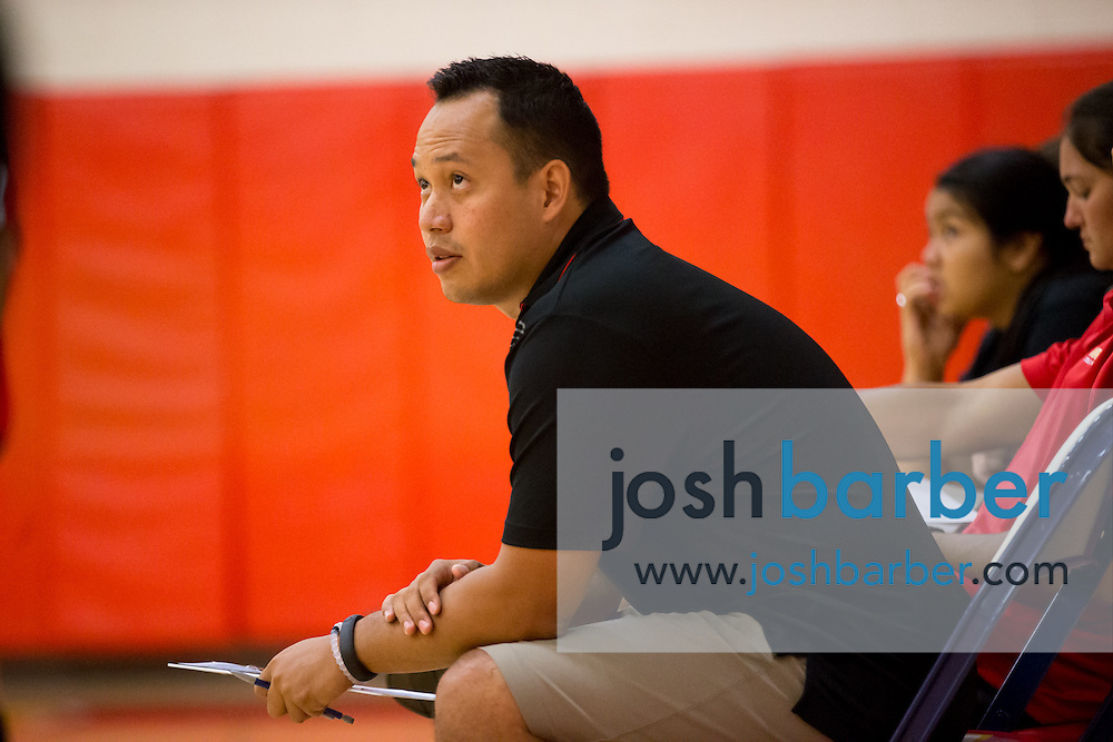 Head coach Darren Ong during a non-league girl's volleyball match between the Canyon Comanches and Rosary Royals at Rosary Academy on Thursday, September 17, 2015 in Fullerton, California.