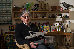 Retired product designer turned toy maker, whose many innovations became iconic household names Tom Karen is photographed with toys he created from recycled materials at his home in Cambridge, UK.<br /> PICTURED: Tom holds a model of an airliner concept that uses a box wing design and a flat, wide fuselage, requiring a shorter wingspan and allowing for greater flexibility with the interior layout. <br /> Cambridge, March 01 2018.