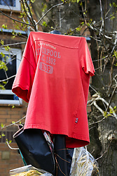 A Liverpool shirt fades in the sun at the spot where keen supporter Abraham Badru was shot. Abraham Badru, a personal trainer, 26, was shot in the chest on 25th March in Ferncliff Road, E8. He received a National Police Bravery Award after intervening in a rape and giving evidence in court. London, April 25 2018.