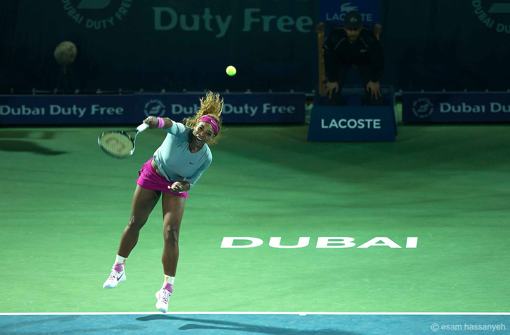 Serena Williams serves in the Barclays ladies tennis championships in Dubai.<br /> <br /> This angle gives a sense of the power and aggression of her serving.