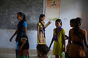 Ahead of Karate practice, Tabasum Khatun, 14, is standing with other girls, inside a class of the local school in Algunda village, pop. 1000, Giridih District, rural Jharkhand, India.
