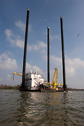 25 Sept, 2005. Lake Calcasieu, Louisiana.  Hurricane Rita aftermath. <br /> Oil industry rig support platforms prepare to put to sea to repair damaged rigs in the Gulf of Mexico to keep the oil flowing to the U.S. mainland.<br /> Photo; ©Charlie Varley/varleypix.com
