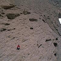 CHINA, Xinjiang. Gordon Wiltsie (MR) near huge Shipton's Arch, one of earth's biggest, in arid Kara Tagh Mountains, near Kashgar.