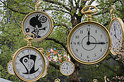 Giant watches decorate the square - Alice Through the Looking Glass premiere - a Walt Disney American fantasy adventure film directed by James Bobin, written by Linda Woolverton and produced by Tim Burton. It is based on Through the Looking-Glass by Lewis Carroll and is the sequel to the 2010 film Alice in Wonderland. The film stars Johnny Depp, Anne Hathaway, Mia Wasikowska, Rhys Ifans, Helena Bonham Carter, and Sacha Baron Cohen and features the voices of Alan Rickman, Stephen Fry, Michael Sheen, and Timothy Spall.