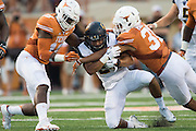 AUSTIN, TX - SEPTEMBER 19:  Khalfani Muhammad #29 of the California Golden Bears is brought down by Jason Hall #31 and Peter Jinkens #19 of the Texas Longhorns on September 19, 2015 at Darrell K Royal-Texas Memorial Stadium in Austin, Texas.  (Photo by Cooper Neill/Getty Images) *** Local Caption *** Khalfani Muhammad; Jason Hall; Peter Jinkens