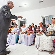 CAPTION: Training of frontline workers (FLWs) is being rolled out in phases. Topics include developmental changes among adolescents and their consequences; nutritional requirements and how to meet them, plus what happens if they are not met; family planning; reproductive tract infections (RTIs) and sexually transmitted infections (STIs); menstrual hygiene; non-communicable diseases; and how to counsel on all of these things. Of these, counseling takes the major focus. LOCATION: Ghatshila Community Health Centre (CHC), Purbi Singhbhum (district), Jharkhand (state), India. INDIVIDUAL(S) PHOTOGRAPHED: Left: Dr Jagannath Hembrom; right: multiple people.