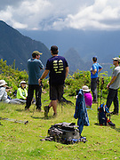 A group of hikers relaxes and enjoys the view of Machu Picchu from Llactapata, Peru. Llactapat is presumed to be on an Incan outpost near Machu Picchu.