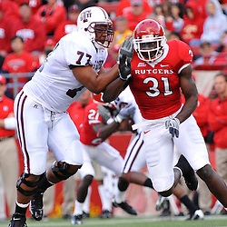 Oct 10, 2009; Piscataway, NJ, USA; Rutgers defensive end George Johnson (31) battles Texas Southern offensive lineman Ernest McCoy (77) during first half NCAA college football action between Rutgers and Texas Southern at Rutgers Stadium.