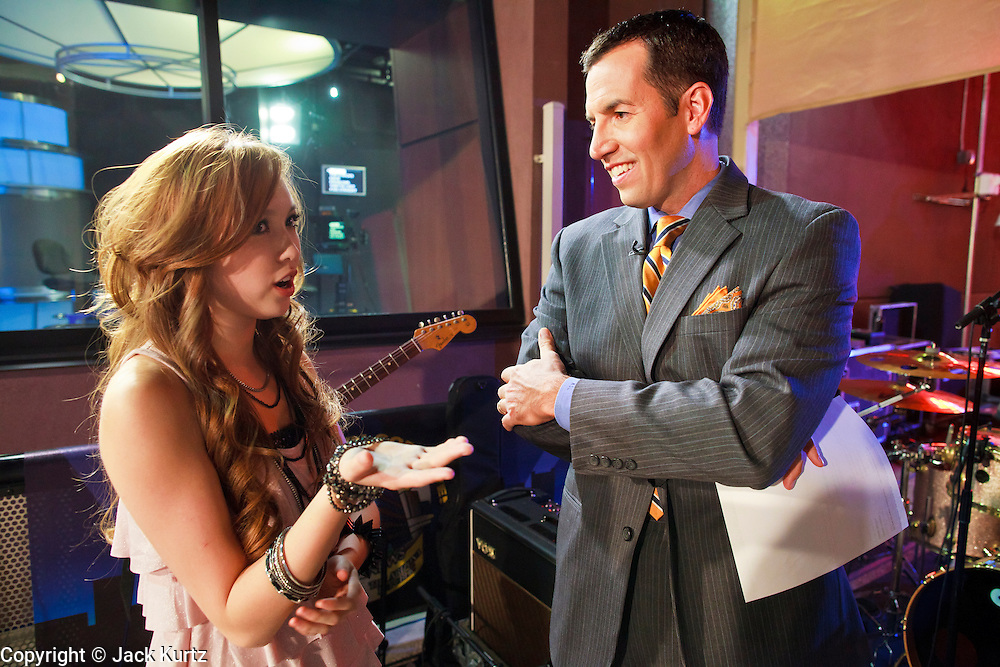 13 MAY 2011 - PHOENIX, AZ: Kylee chats with KPNX anchor Scott Light during her show on the plaza at 200EVB Friday night. Kylee Saunders is a teen pop sensation in Japan, but a normal high school student in Chandler, where she lives. The teenager has a recording deal with Sony and commutes from Arizona to Japan to promote her records.      PHOTO BY JACK KURTZ