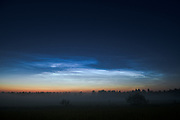 "Night sky and noctilucent clouds over Dviete floodplains in summer, nature park ""Dvietes paliene"", Latvia Ⓒ Davis Ulands 