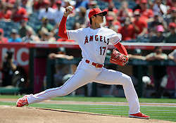 April 8, 2018 - Anaheim, CA, U.S. - ANAHEIM, CA - APRIL 08: Los Angeles Angels of Anaheim pitcher Shohei Ohtani (17) throws his first carrier home game pitch for the Angels at Angel Stadium of Anaheim during the first inning of a game against the Oakland Athletics played on April 8, 2018 at Angel Stadium of Anaheim in Anaheim, CA (Photo by John Cordes/Icon Sportswire) (Credit Image: © John Cordes/Icon SMI via ZUMA Press)