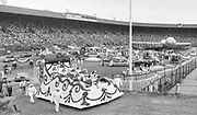 "June 9, 1950. ""STADIUM. Hundreds of thousands of blooms and untold labor went into the construction of the floats that appeared early Friday in Multnomah stadium, where the judging was done for the Grand Floral parade that climaxed annual Portland Rose Festival.""  (on the left exiting the stadium is the Queen's float carrying the queen and her princesses)"