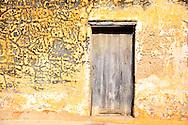Weathered wall and door in Gibara, Holguin, Cuba.