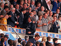 Chelsea Chairman Ken Bates exchanges words with Manchester United Manager Sir Alex Ferguson as he offers him his losers medal. Chelsea v Manchester United. FA Charity Shield. Wembley 13/8/00. Credit: Colorsport.